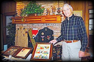 Johnny Sproles shows some of the memorabilia and accolades he has  collected over the years as a Boy Scout, as well as during his time in  the military.