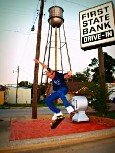 Overton skateboarder leaps off sidewalk, 2010