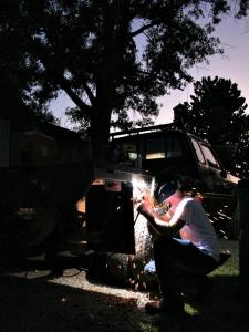 Overton welder repairing his truck, 2009